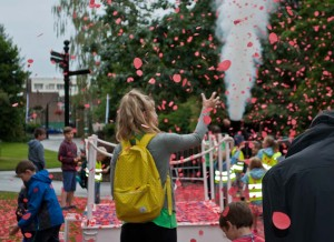 Audience play with poppy petals for World War One Centenary