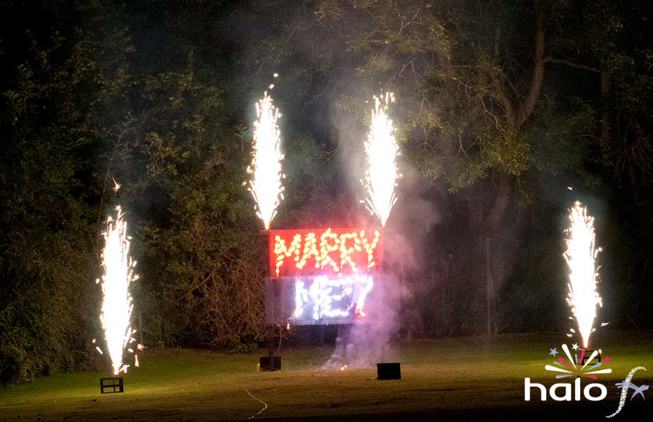 Will you marry me in red and blue firework writing lancework with silver fountains as well taken at Brownsover Hall