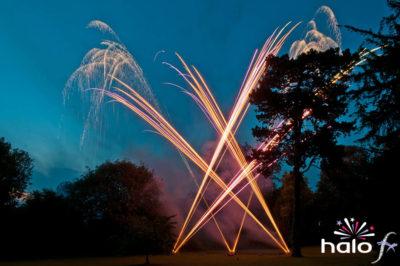 Crossing orange and purple roman candle fireworks at Simon and Yasmins wedding fireworks display