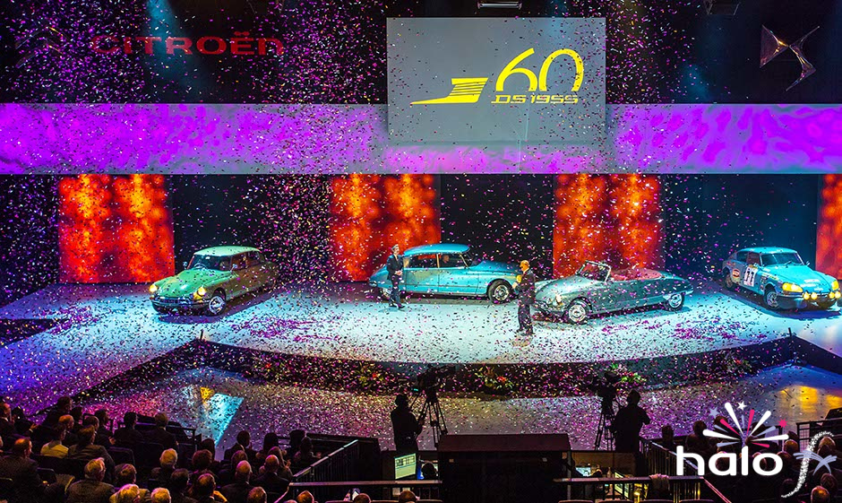 Citreon Dealers Conference at NIA Birmingham pink and silver confetti falling over cars on stage