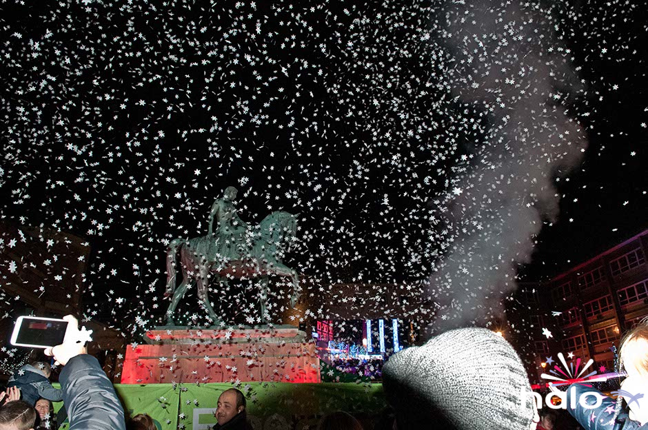 A heavy fall of white snow flake confetti swirling around Lady Godiva statue during the Coventry Christmas Lights switch on event