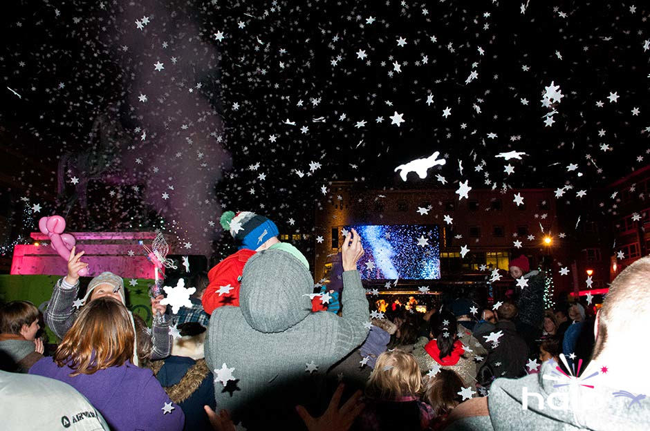 A fall of snow flake confetti over the crowd at the Coventry Christmas lights switch on event
