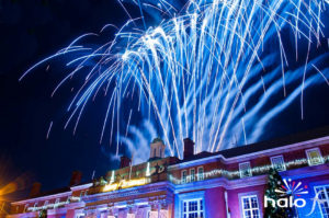 Blue crossette fireworks fanning above Nuneaton Town Hall for the Christmas Lights Switch On event choreographed to Let it Go from Frozen