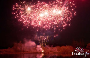 Beautiful red glitter fan cake firework as part of a Scattering ashes fireworks display next to a lake near Oxford