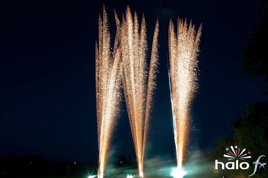 Three gold brocade mines as part of a music and fireworks choreographed scattering ashes fireworks display in Cornwall